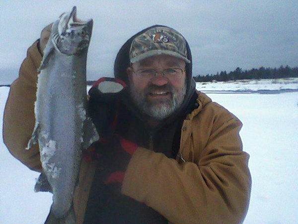 Dan Plue with an ice fished Steelhead