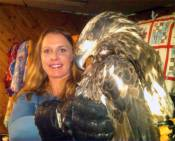 """I rescued this immature American Bald Eagle at the mouth of the Hog Island Creek with the help of the Good Samaritan (who called 911 when he saw it couldn't fly and it walked out to his predator decoy), and a Michigan State Trooper. With in minutes of the rescue, Randy Bruntjens of U.P. Raptor Rehabilitation Center was en route on the long ride to come pick """"Creek"""" up.  Creek was nearly starved and dehdrated and couldn't fly. Unknown cause at this point."""